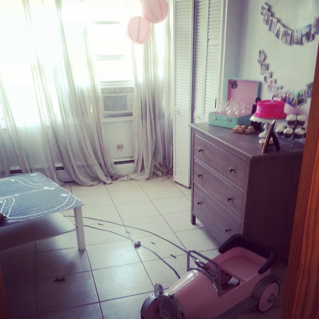 Bedroom turned into party room, complete with car table, cake table, and winding road