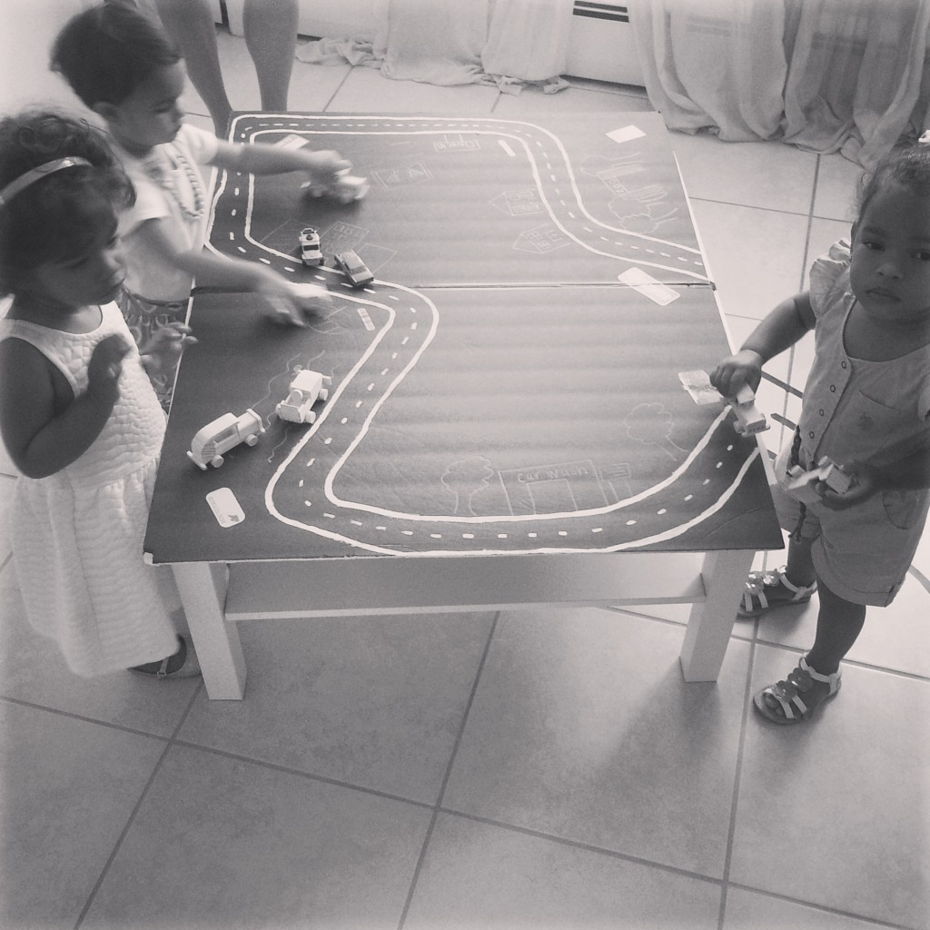 Toddlers enjoying the car table