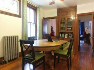 The cabinet in the dining room was filled with board games for families to enjoy